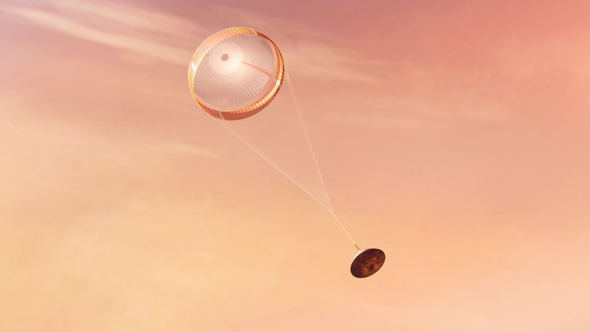 An artist's rendering of a spacecraft descending through the Martian atmosphere on its parachute