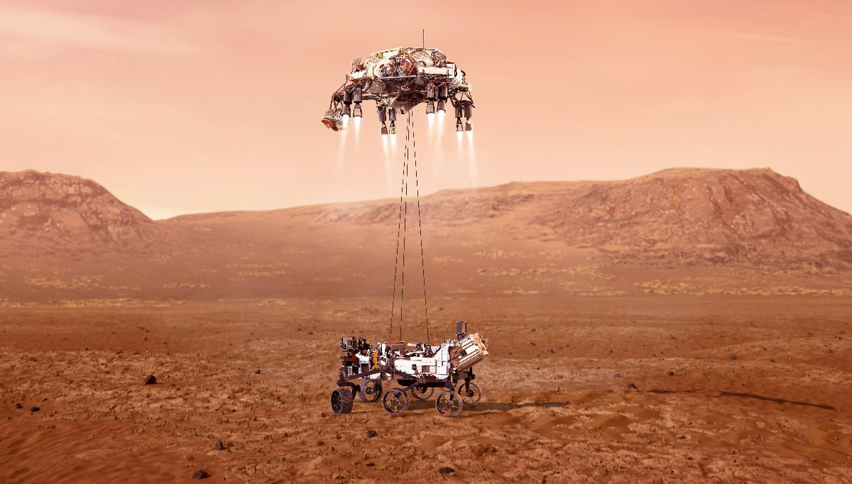 The rover, now descended from the sky crane, rests on the Martian surface. The rocket-powered backpack hovers above.