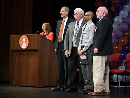 Staff honorees on stage