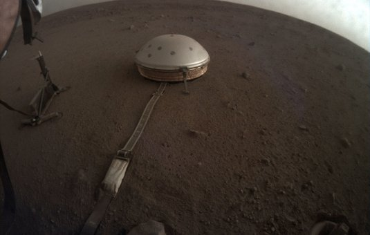 Clouds drift over the dome-covered seismometer, known as SEIS, belonging to NASA's InSight lander.