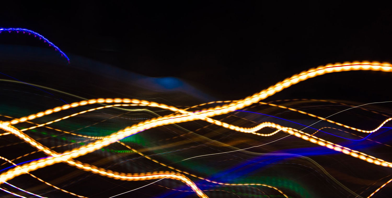 Streaks and swirls of colorful light on a black background