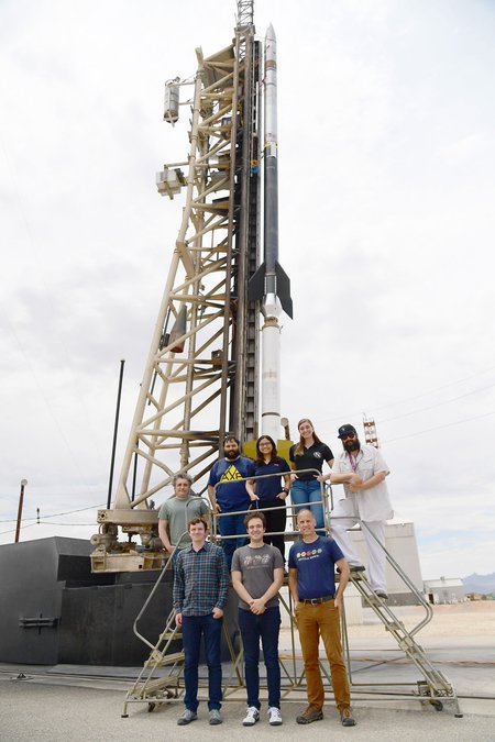 The CIBER-2 team poses with the rocket experiment.