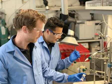 Researchers conduct laboratory work to convert carbon dioxide to ethylene.