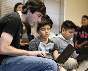 A Caltech senior helps a third-grade boy learn to code.