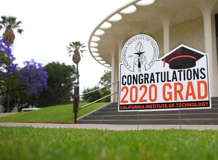 A sign in front of Beckman Auditorium offers congratulations to the Class of 2020.