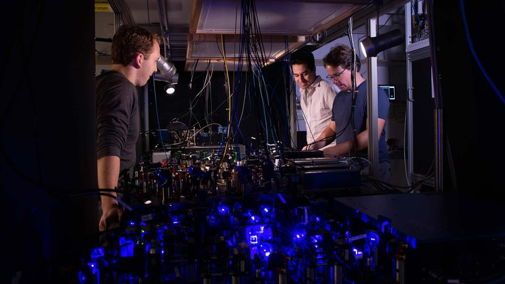Adam Shaw, Ivaylo Madjarov and Manuel Endres in the lab.
