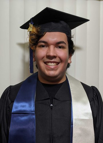 A portrait of Erik Herrera wearing a graduation robe and mortarboard