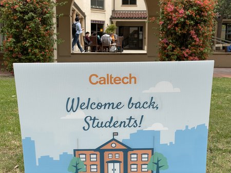 A sign on the lawn welcomes students back to campus.