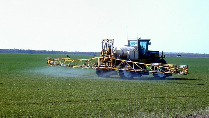 Fertilizer is applied to an agricultural field.