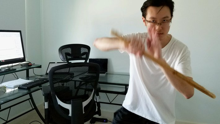 Student Jaeyoung Kang in his apartment practicing Filipino Martial Arts