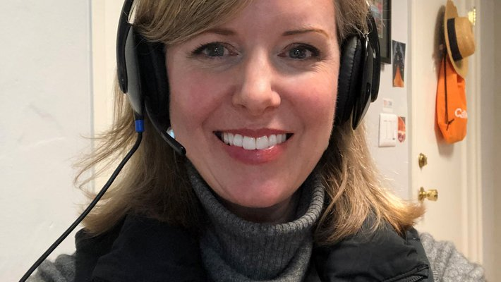 Selfie of woman wearing a headset and smiling