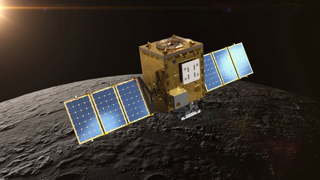 A cubic satellite with rectangular solar panels extending to the left and right. In this artistic rendering, the spacecraft orbits the Moon.