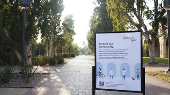 Moore Walk on the Caltech campus with a Caltech Together sign