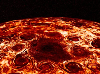 Large storms, each looking like a hurricane, swirl around each other in a false-color image.