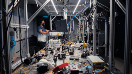 Raju Valivarthi calibrating one of the quantum teleportation nodes