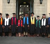 Photo showing the different types of academic regalia worn by graduating Caltech students.