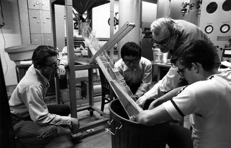 photo of Rolf Sabersky and three others observing sand flow