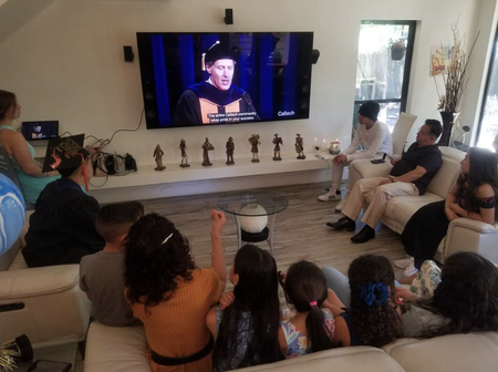 A graduating student's family gathers to watch Caltech's virtual commencement celebration.
