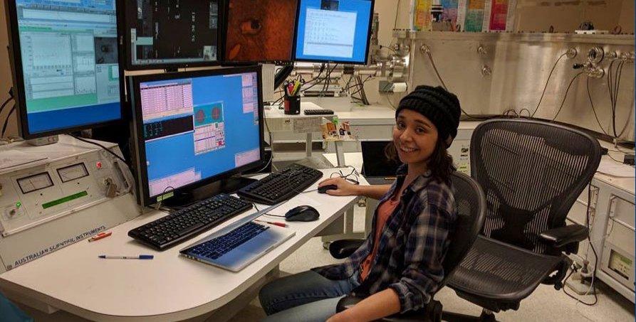Graduate student Emma Sosa sits works at a computer at Caltech