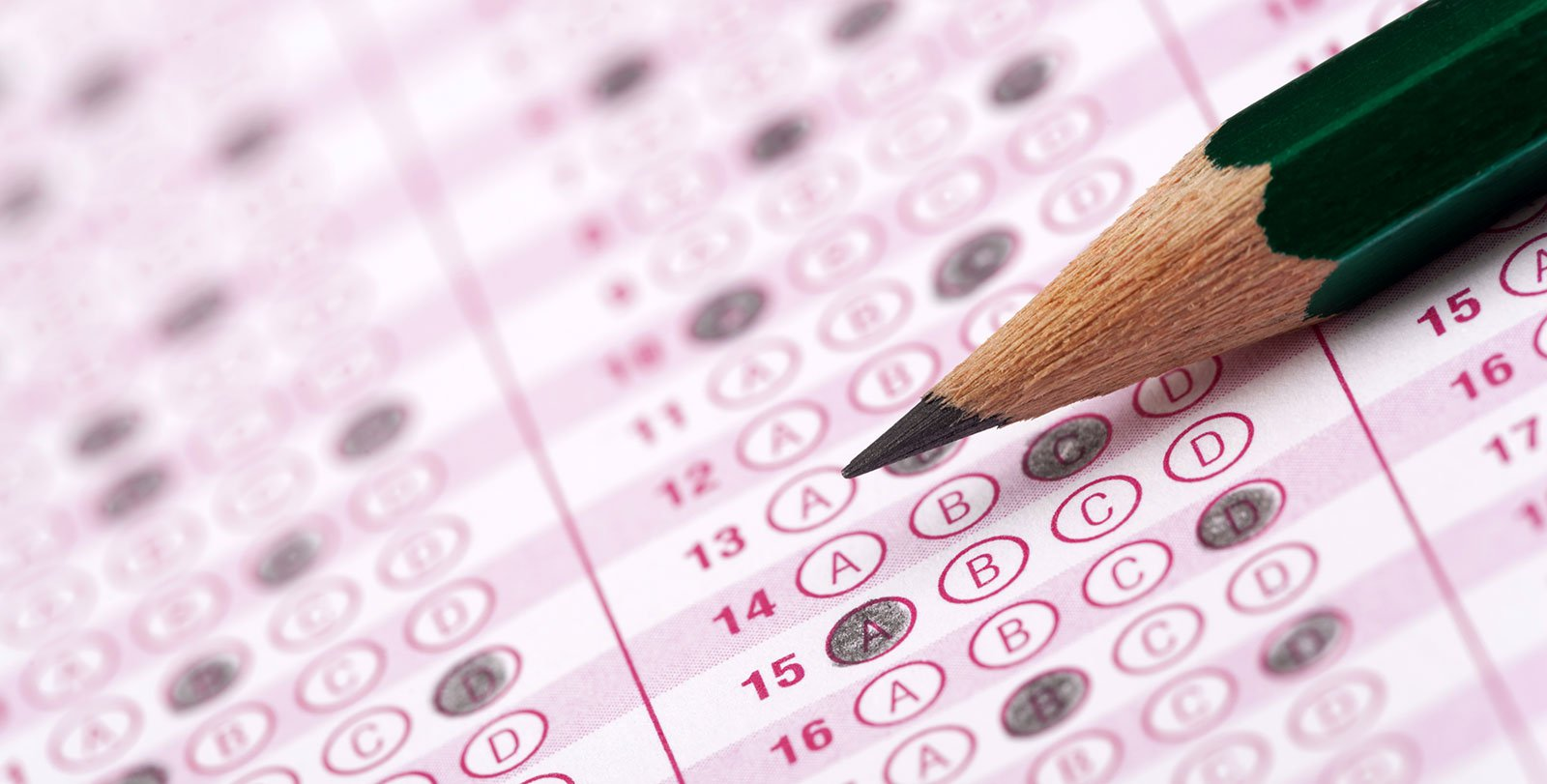 Scantron sheet with filled-in answer bubbles and sharpened pencil