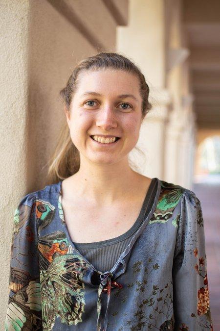 A portrait of Sophie Walton smiling