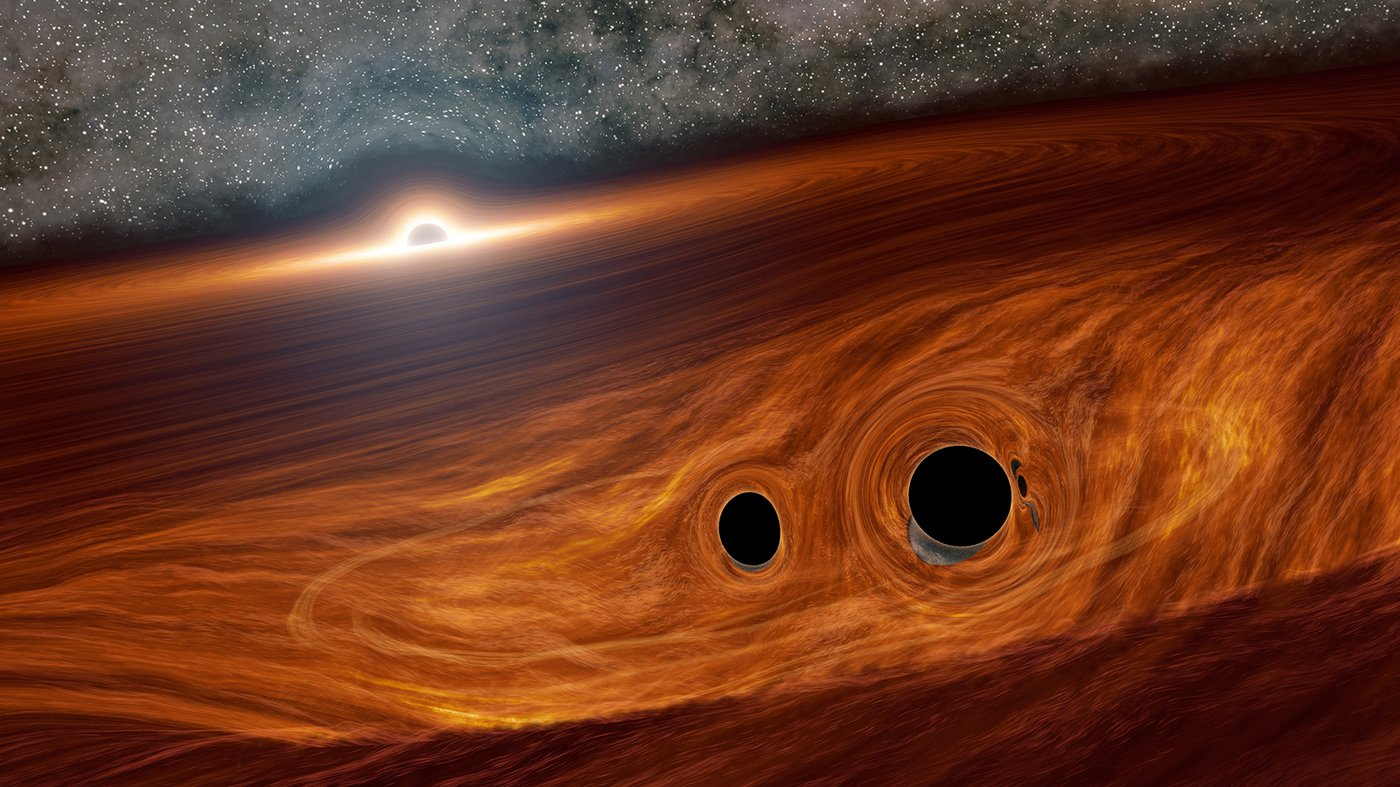 Artist's concept of a supermassive black hole, with a binary pair of black holes in its disk.