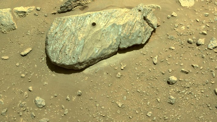 Picture of Martian rock with a hole in it.
