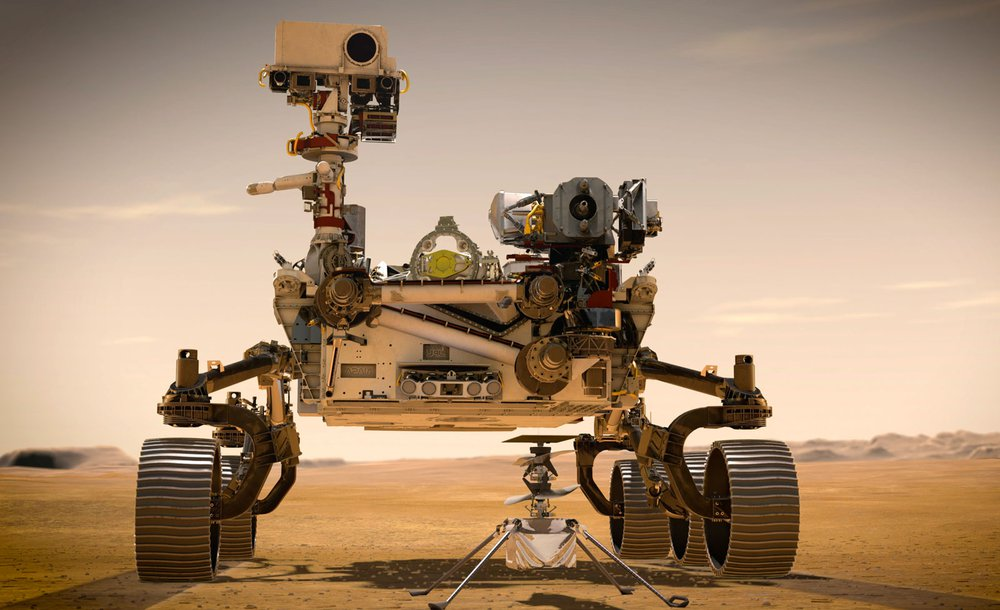An artist's rendering of the Perseverance rover and the Ingenuity helicopter. The helicopter sits on the ground in front of the rover and is much smaller in comparison.