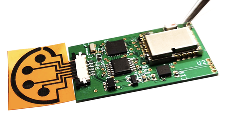 An orange-and-black sensor attached to a small circuit board.