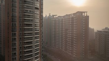High-rise apartment buildings are shrouded by air pollution in Shanghai.