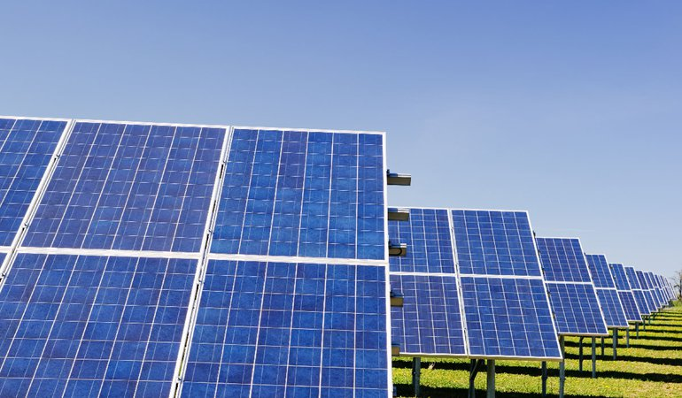 Solar panels in a grassy field