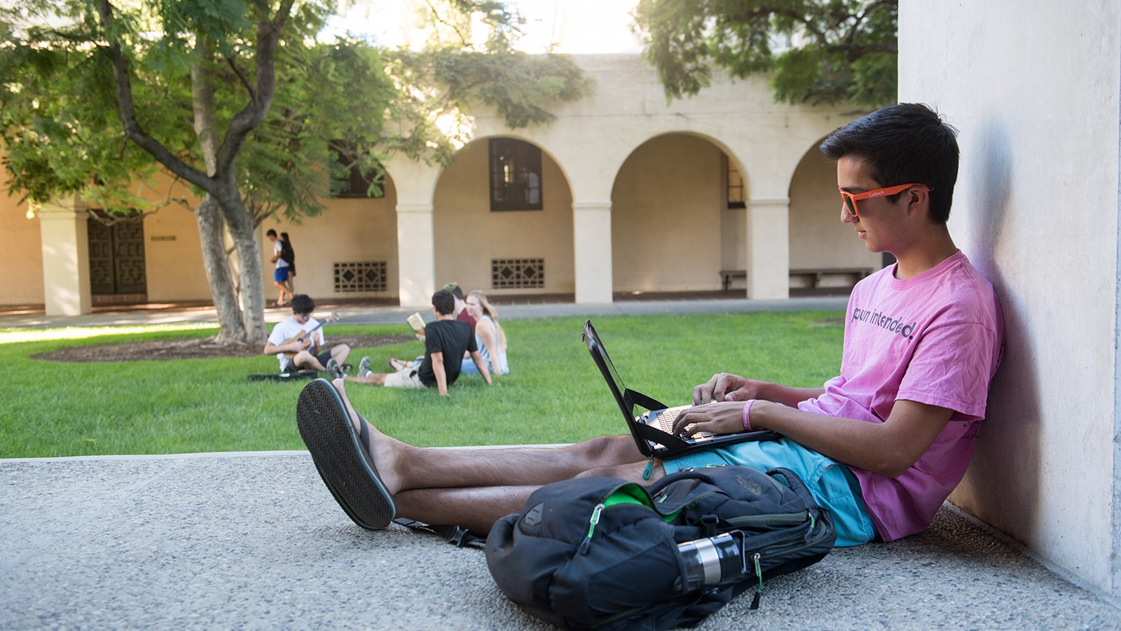 student sitting outside at Caltech