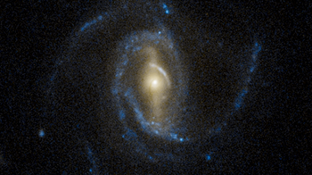 A super spiral galaxy captured by the Hubble Space Telescope.